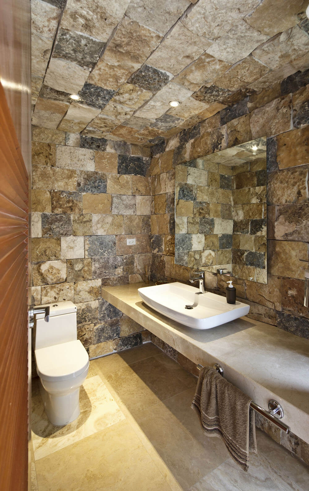 Yucatan cantilevered house stone on bathrom walls and ceiling