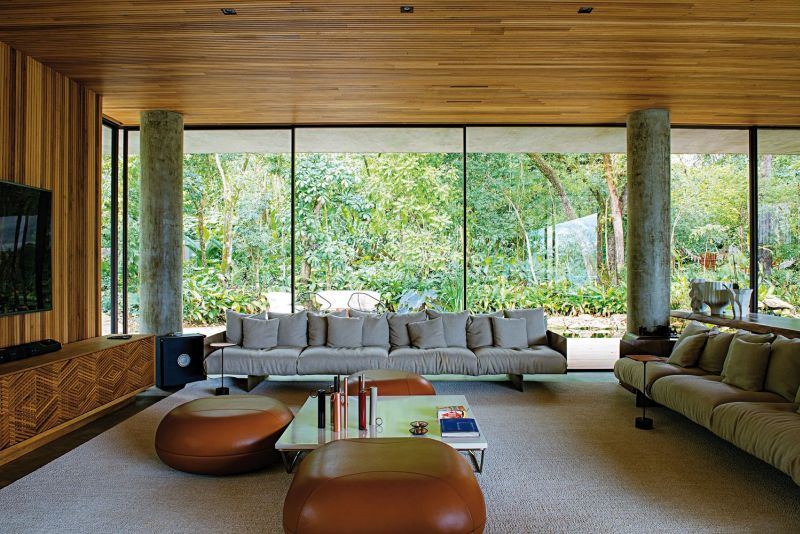 The hillside and the forest act as a wonderful backdrop for this spacious lounge area