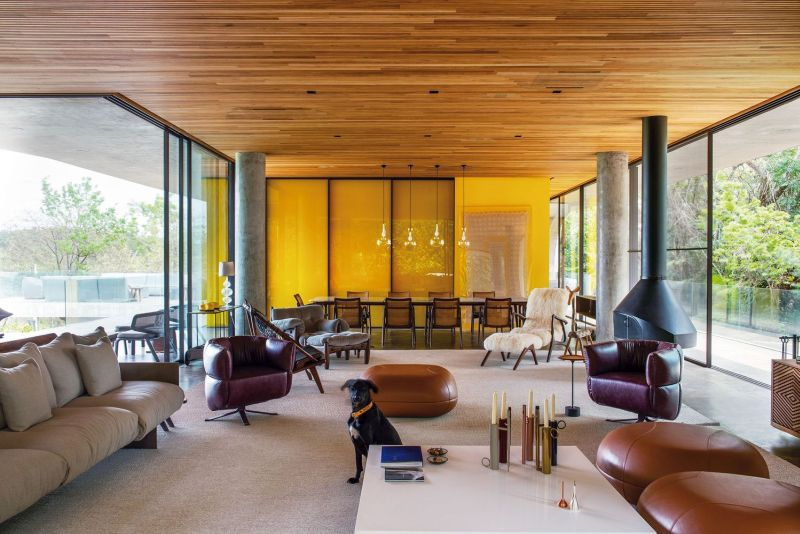 The living room is open on two sides, with covered terraces that overlooks the surroundings