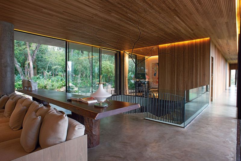 The concrete floors act as an intermediary between the interior and exterior design of the house