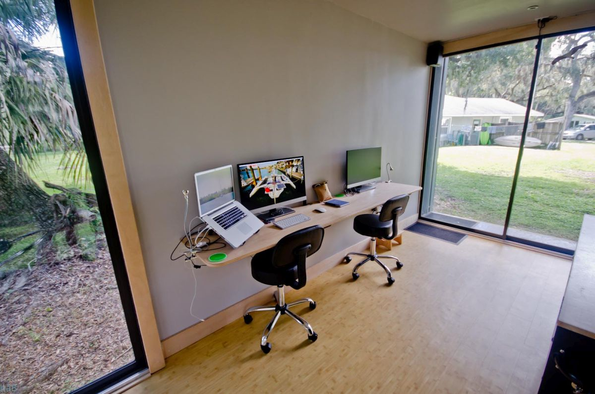 There's also a minimalistic wall-mounted desk that can be shared by two people at the same time