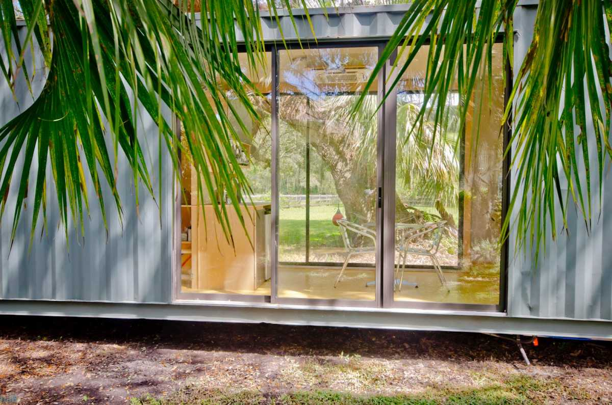 Big windows were placed on opposite sides and allow one to see right through the house