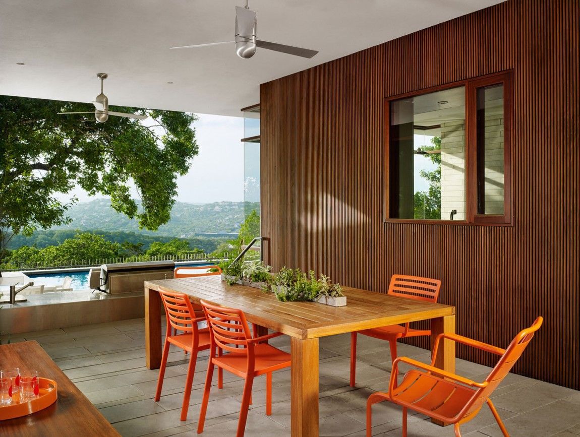 lake view residence dining space with orange chairs