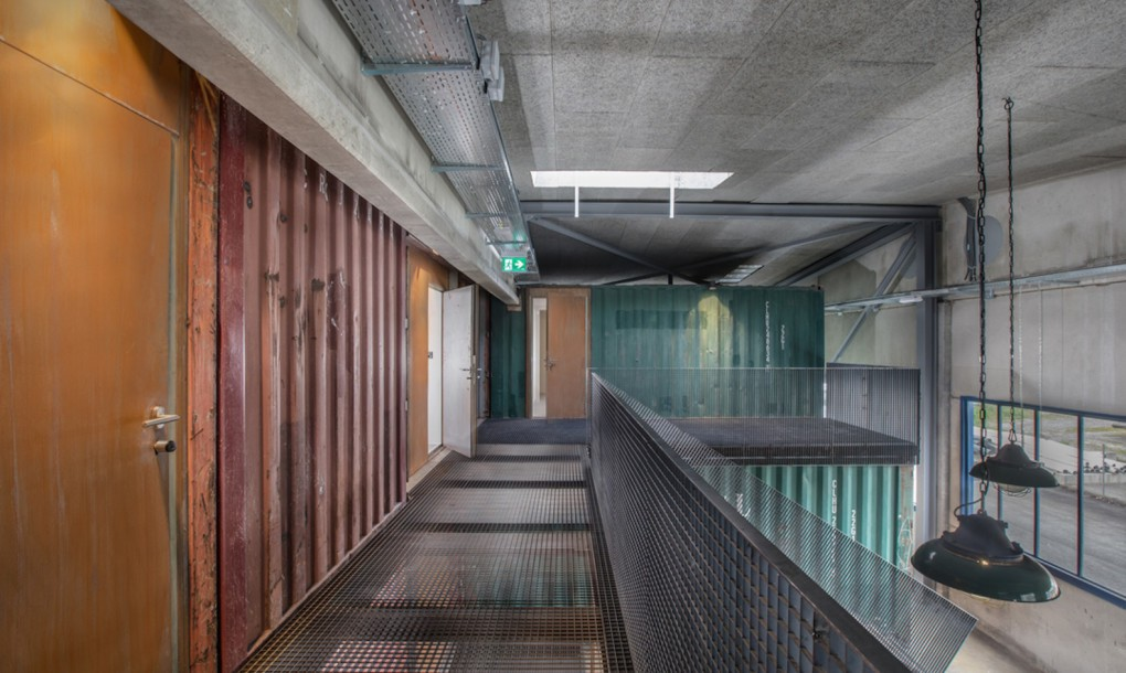 old shipping containers into an edgy concert hall rooms