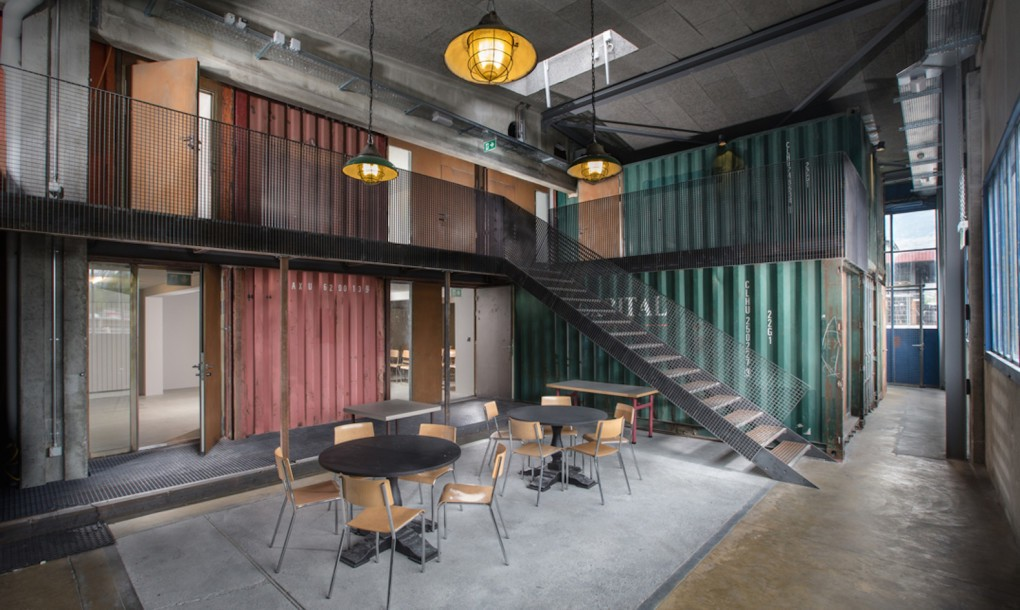 old shipping containers into an edgy concert hall stairs