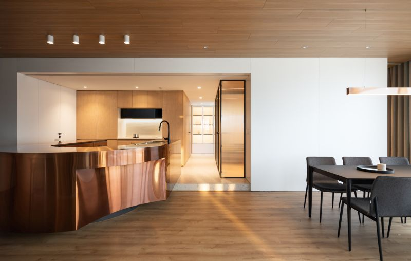 This amazing copper kitchen island is the first thing visitors see when entering the apartment