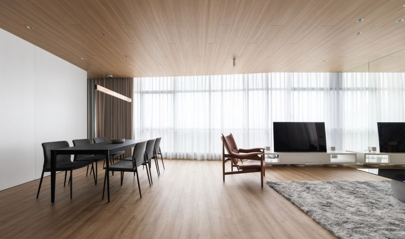 A large social area was created at the center of the apartment by removing interior walls