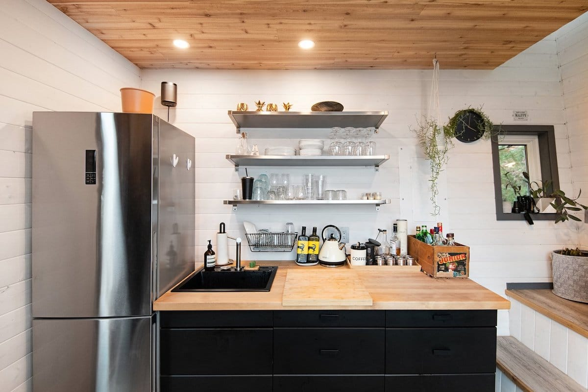 The kitchen is small but has room for a fridge and some counter space