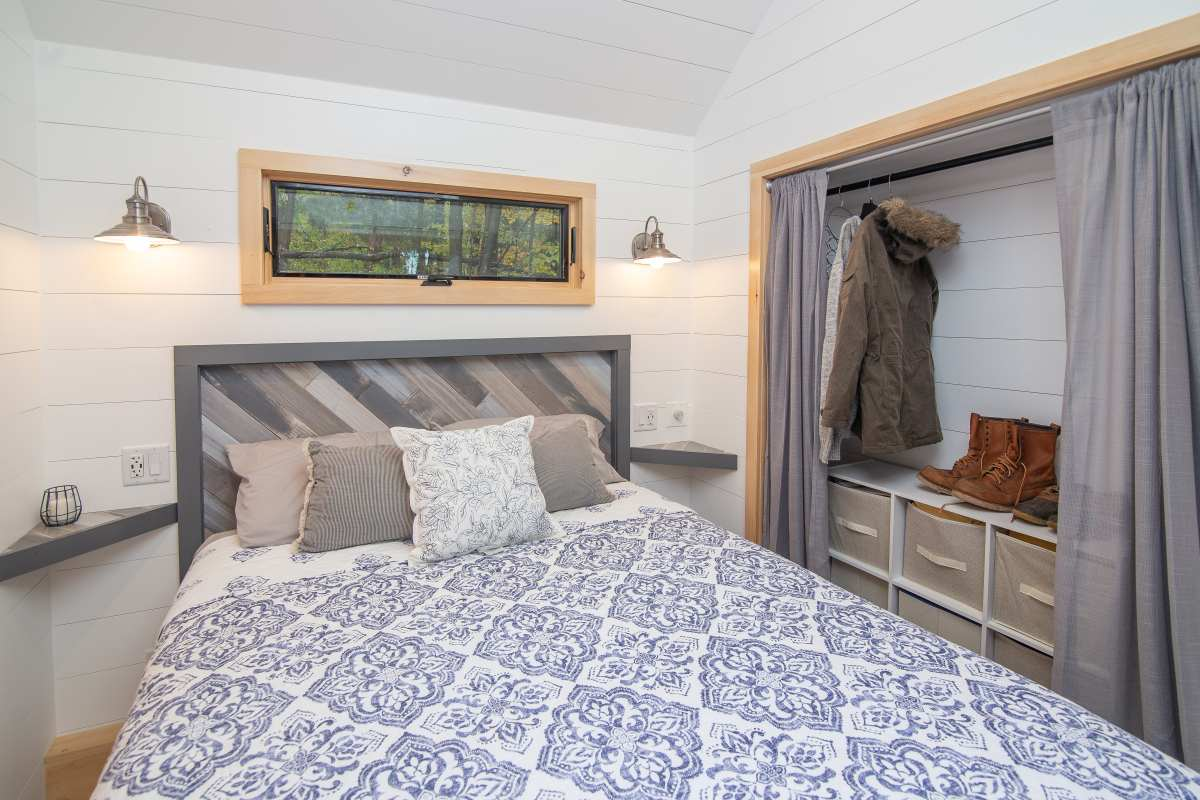 There's enough space in here for a queen-size bed, corner floating nightstands and a closet space