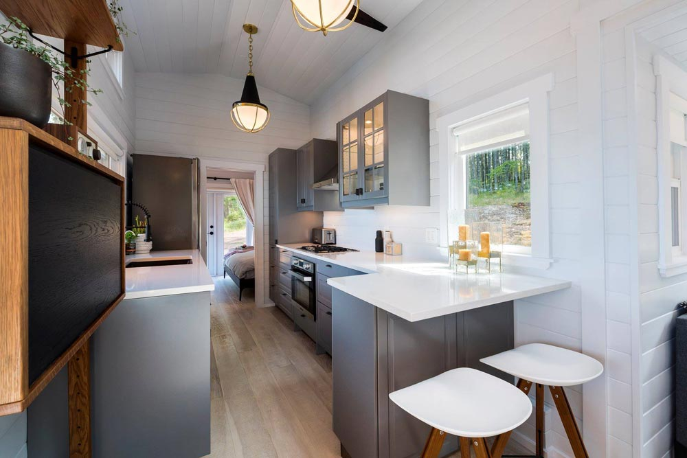 The kitchen is sufficiently big with plenty of storage and even a little breakfast bar