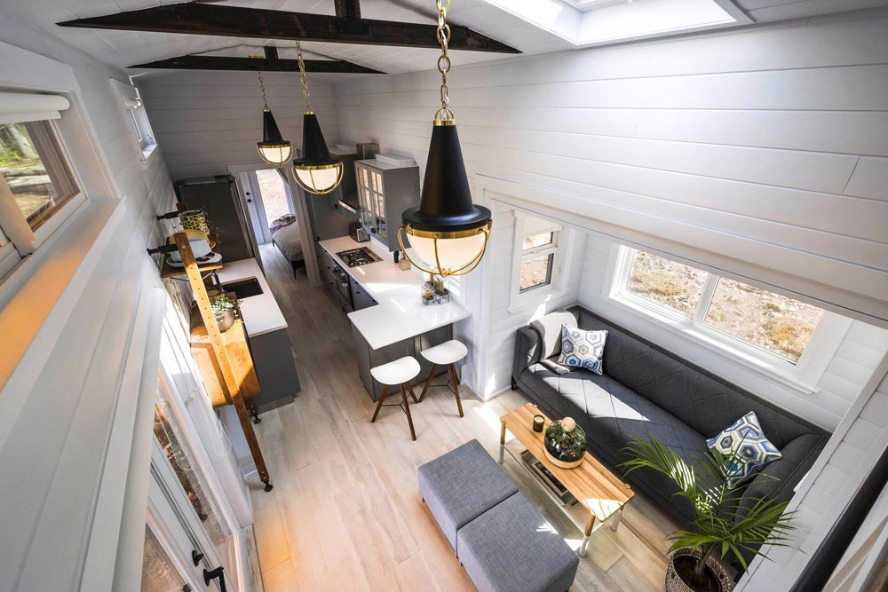 The interior has a long and narrow layout, with the living room, kitchen, bedroom and bathroom being placed in a row