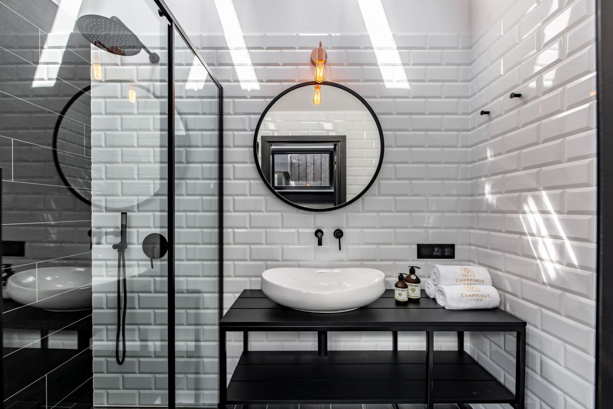 White subway tiles give the bathroom a timeless appearance