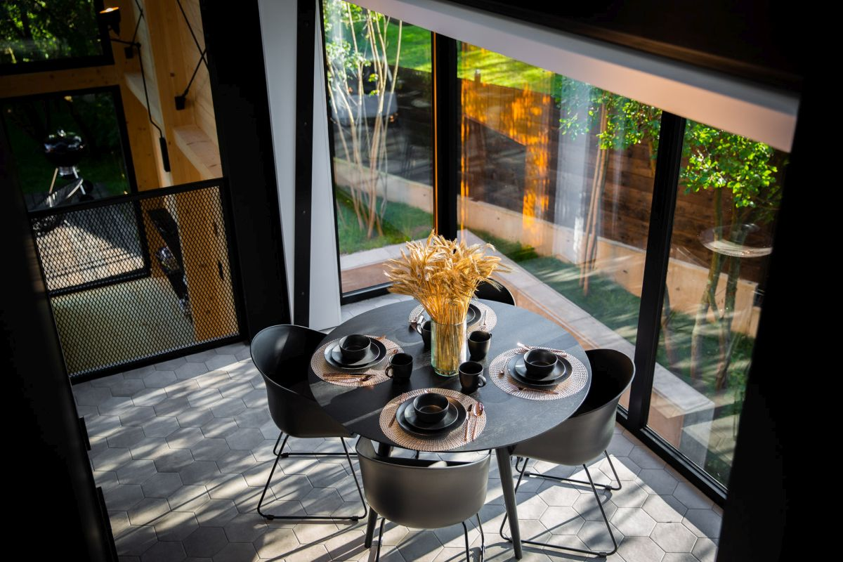 The dining area is small and placed in the corner from where it overlooks the courtyard area