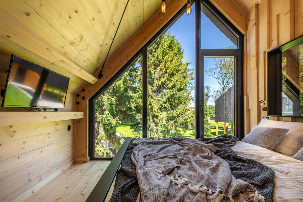 Although small, the bedroom doesn't look or feel tiny thanks large windows