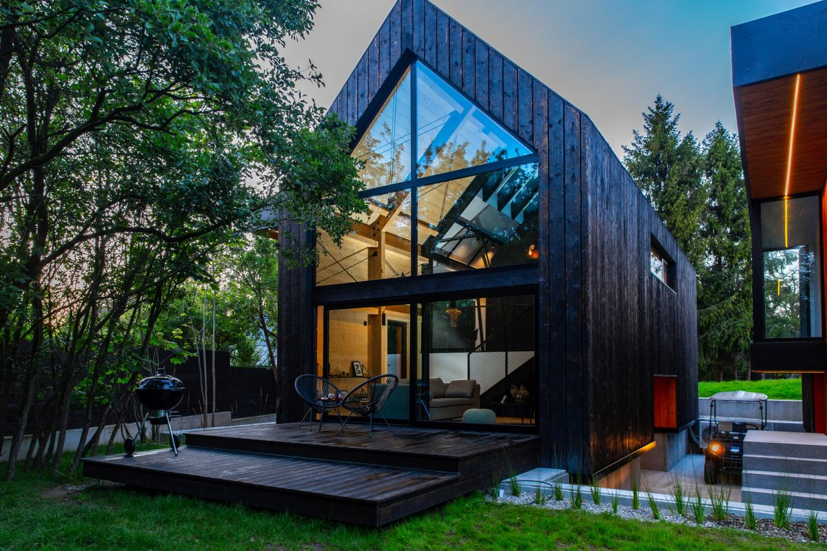 The houses have dark wood frames which help them better blend in with their natural surroundings
