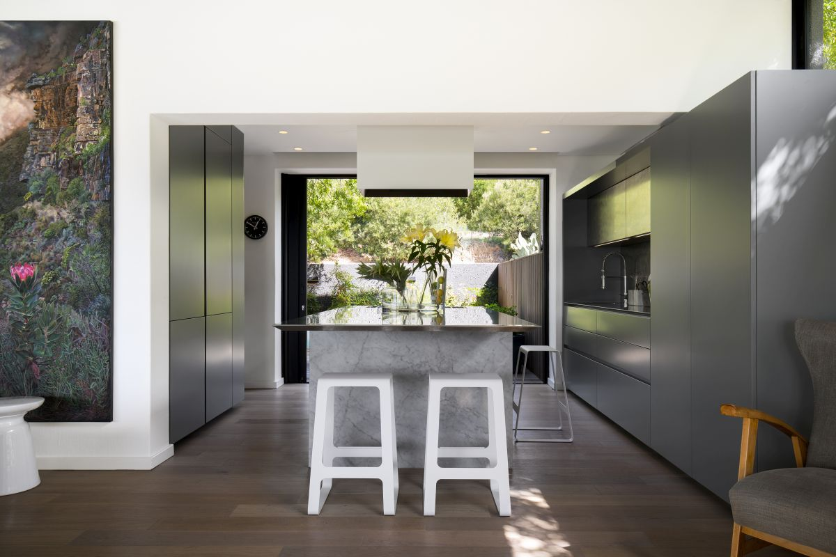The kitchen is connected to the living area but has its own nook which allows it to feel extra welcoming