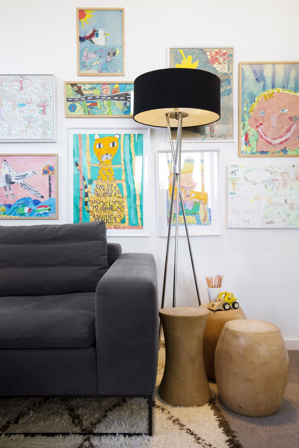 Colorful and cheerful artwork done by the kids covers this wall, giving it a personalized and unique look