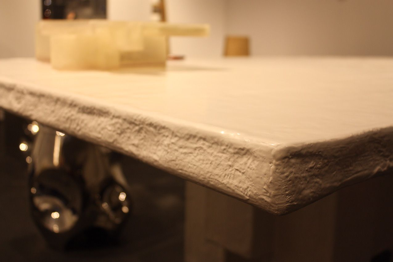 A side view of the table shows that it's not just a plan slab of material.