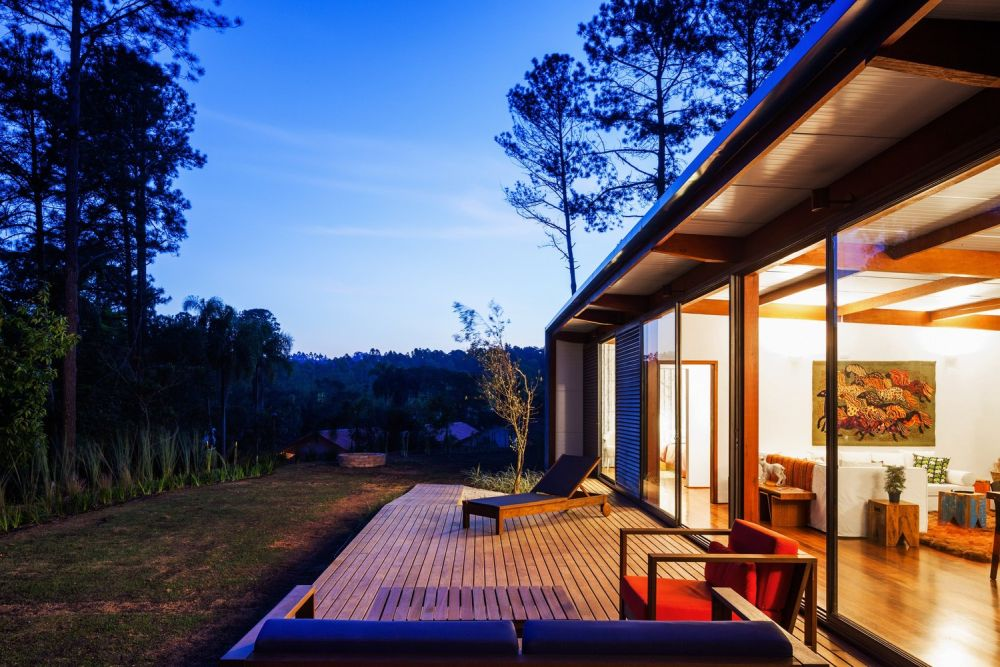 The living area has access to an open wooden deck which can be used as an external sitting area