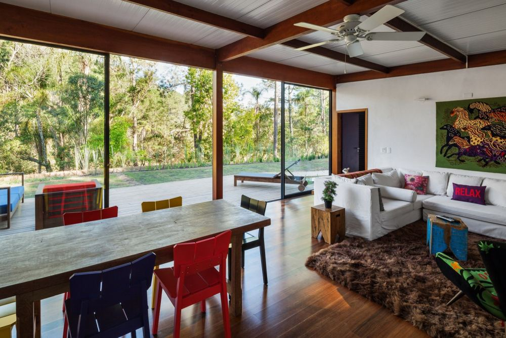 The wooden floors and exposed ceiling beams create a feeling of coziness and comfort inside the house