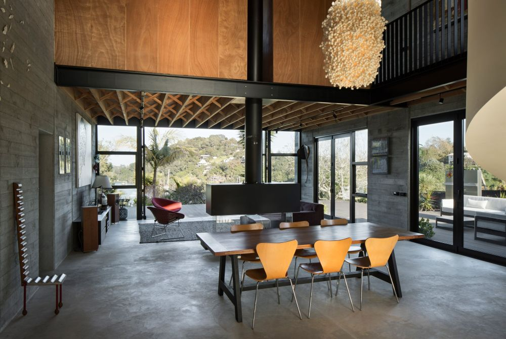 Concrete is mixed with wood and stylish furniture and light fixtures and the combination is exquisite