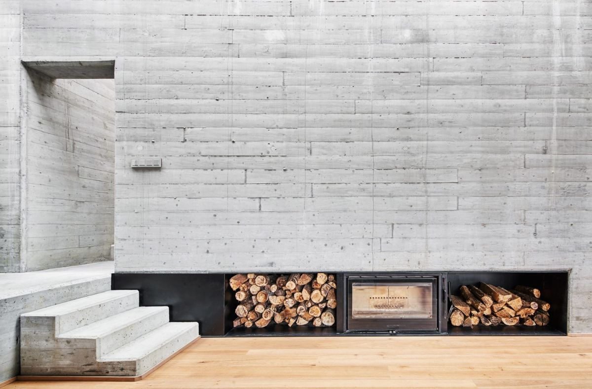 Exposed stone walls add a rustic-industrial vibe to the interior design