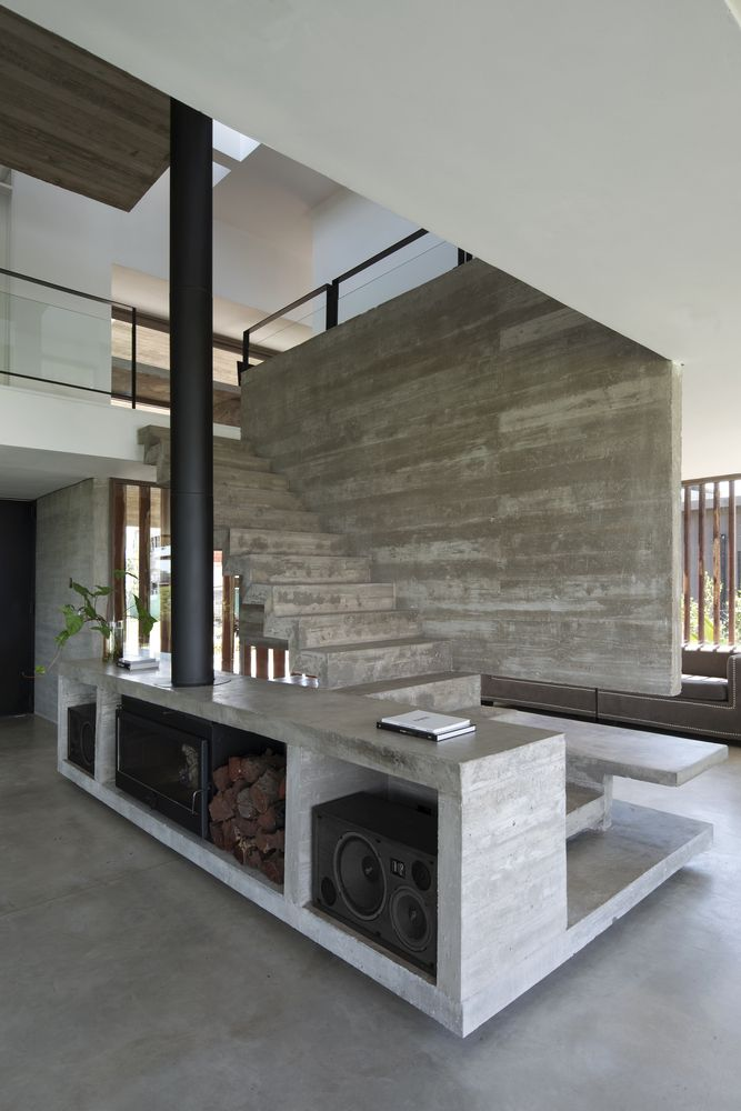 At the core of the house stands a double-height volume which accommodates the social areas