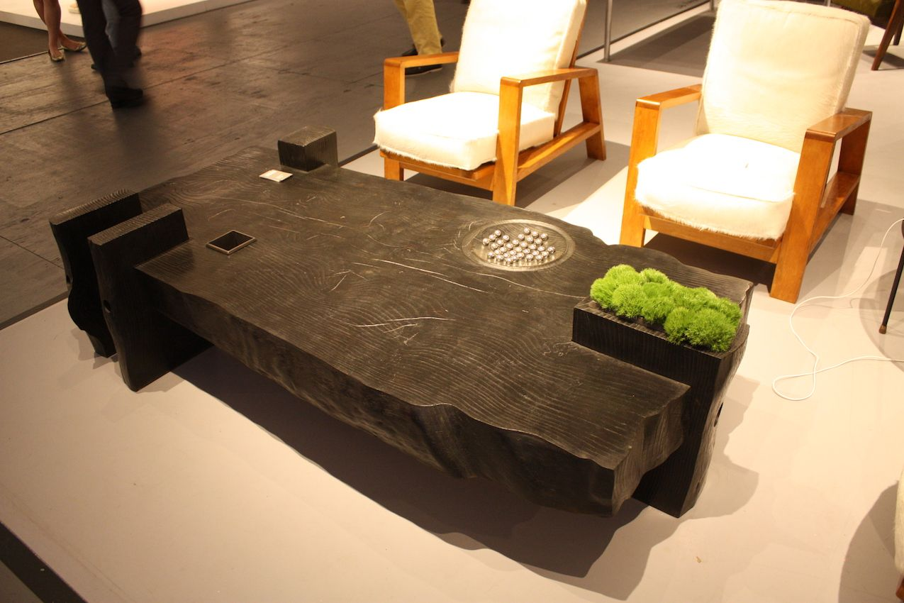 This sturdy table includes a planter and a game detail for interest.