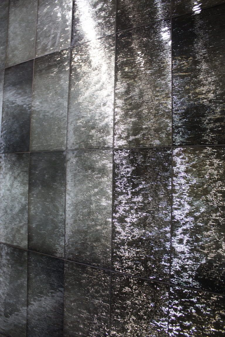 Artistic Tile offers a variety of shiny, metallic tiles like this foiled style.