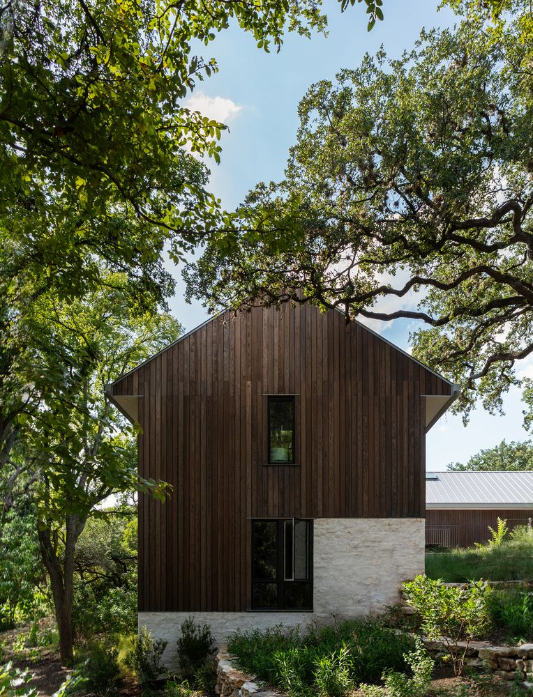 the exterior of the house is built using weathered fir wood and has a very beautiful finish