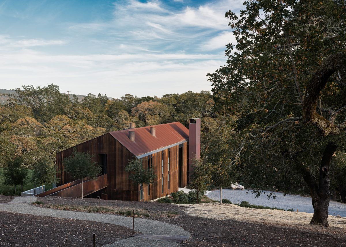 Corten steel was used extensively toegther with weathered wood for the house's exterior