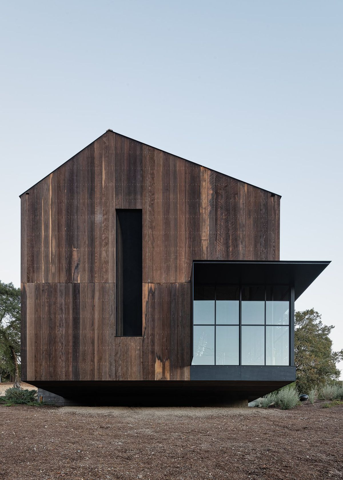 The Big Barn has a clean and simple geometry and is partially clad in reclaimed wood