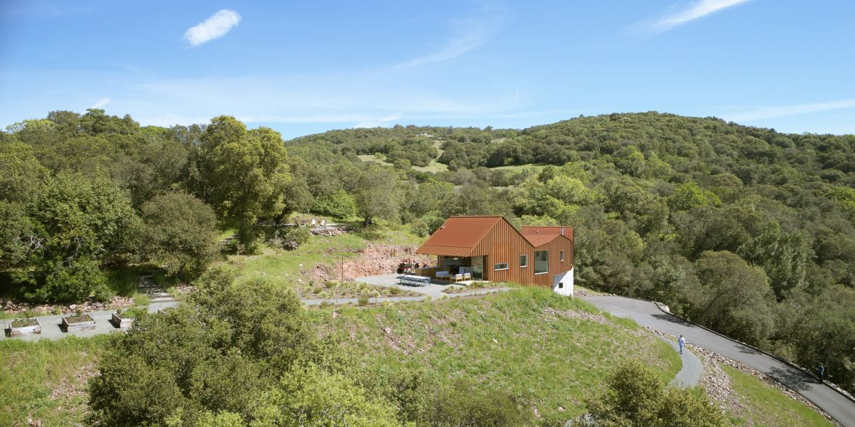 The house was built on a steep hillside on a remote site surrounded by nature from all sides