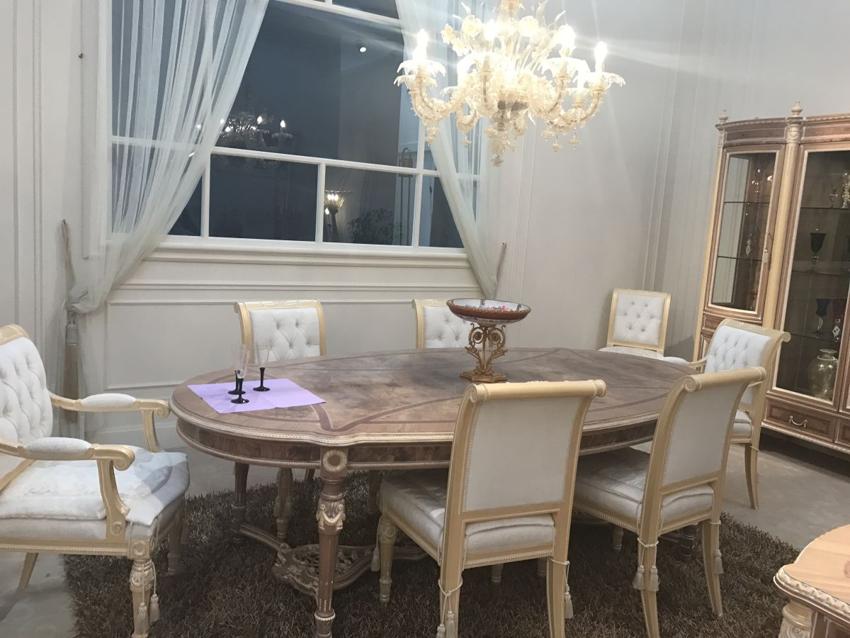 A lighter take on Baroque style distinguished this luxury dining room.