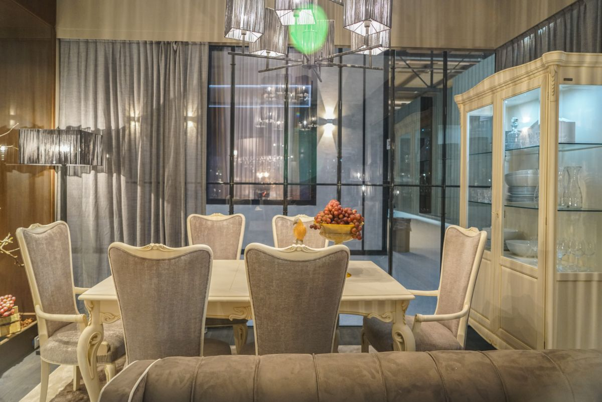 Modern lighting highlights a more current style dining area.