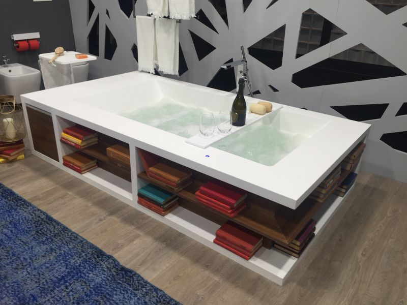 Bathtub with storage for towels and accessories