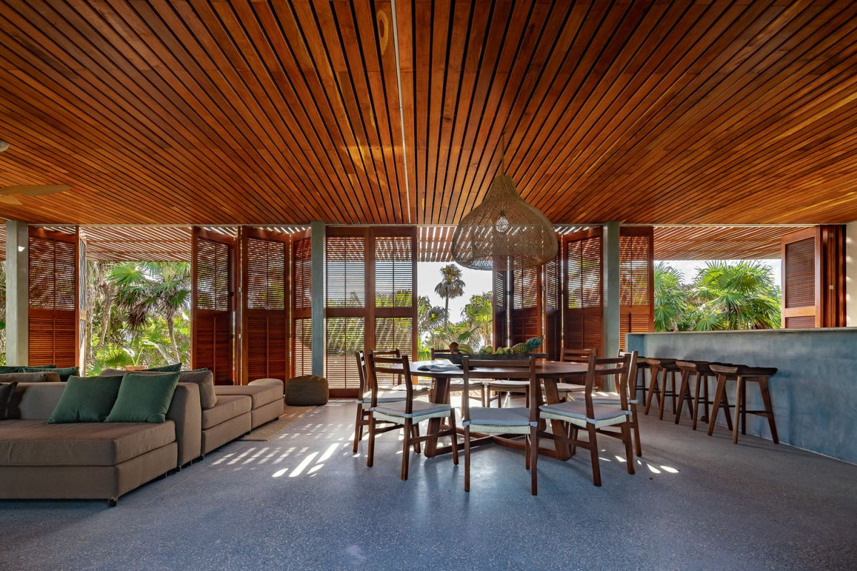 All of the interior living areas are gathered on the intermediate level and seamless expand onto terraces and patios