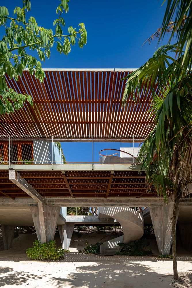 A view below the house reveals the system of columns which support the structure