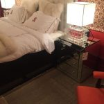 Bedroom featuring a mirrored night stand