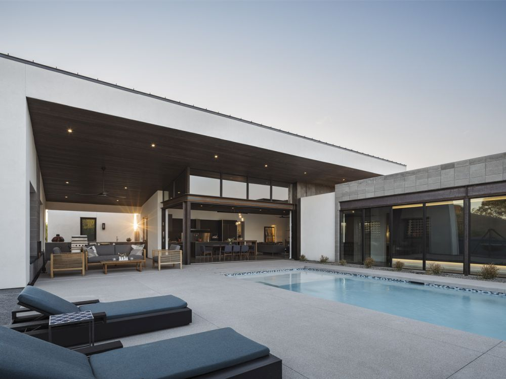 The courtyard features a swimming pool and an open lounge deck