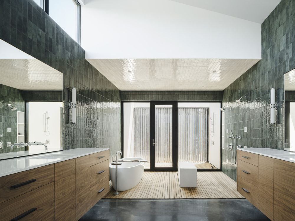 The master bathroom features an outdoor shower and lots of sunlight