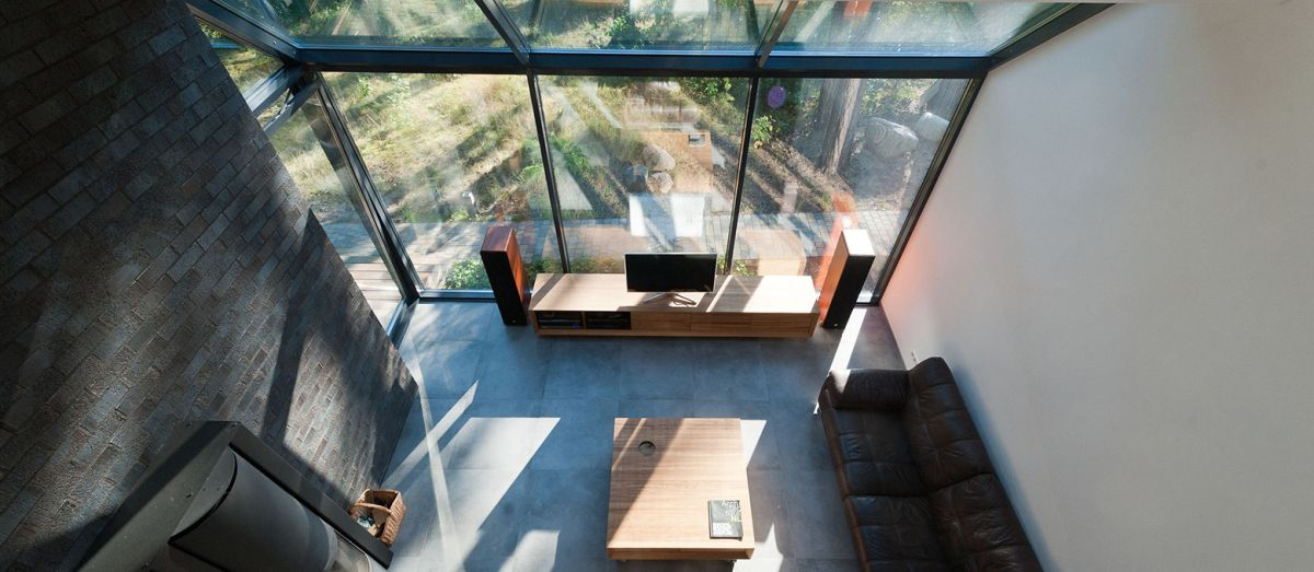The double-height living area was a special request from the owners who wanted it to fill the house with music