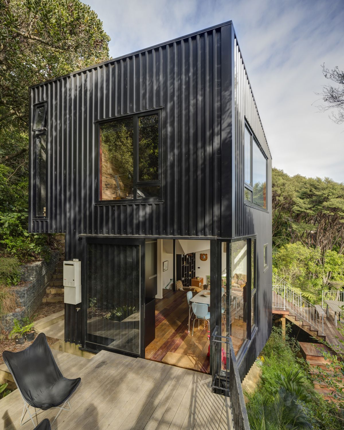 Large openings and panorama windows expose the interior spaces to their beautiful natural surroundings