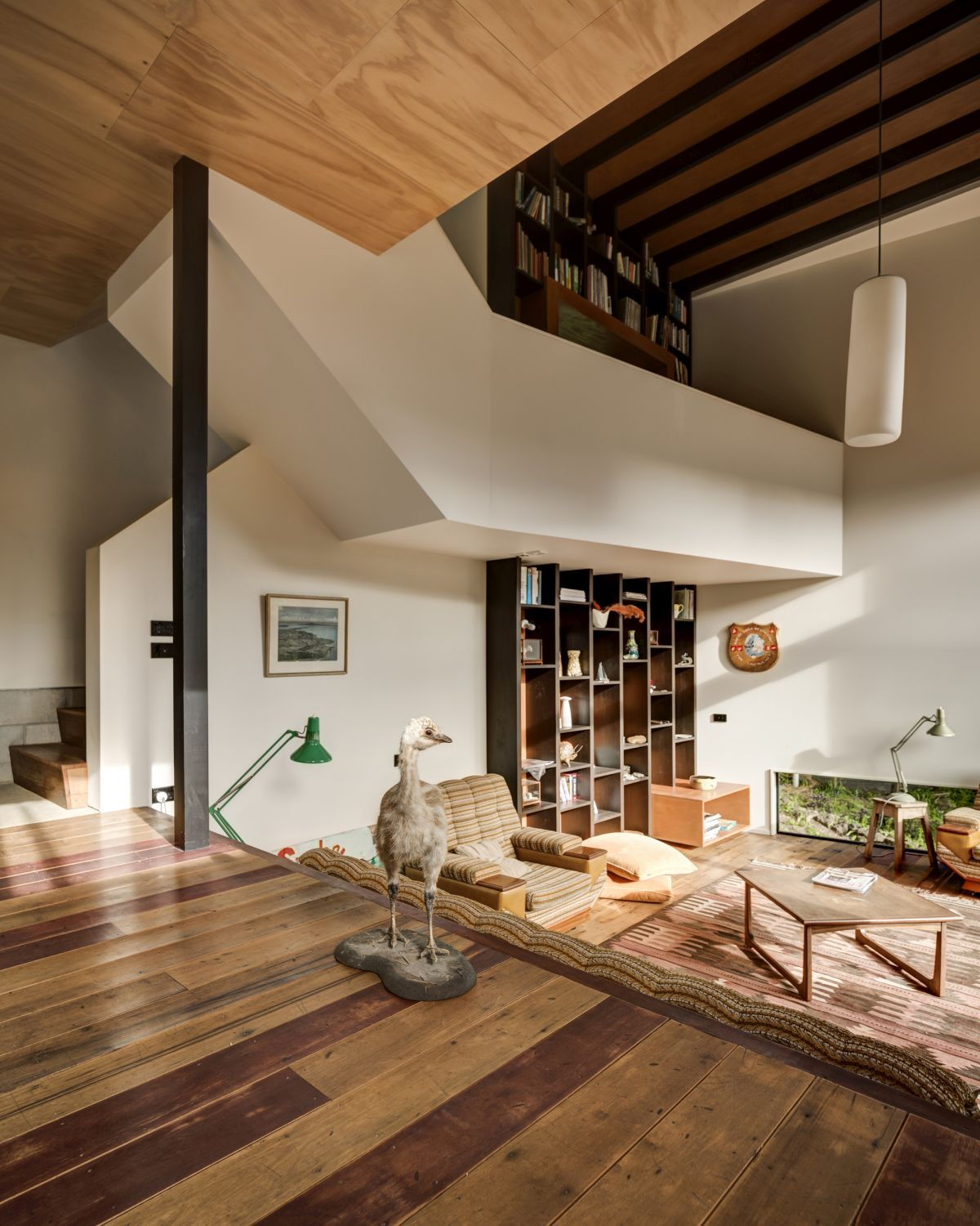 The double-height living room feels very cozy and has a welcoming look
