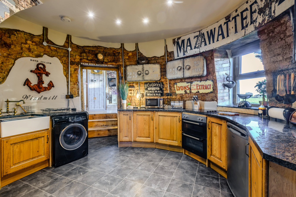The kitchen has an eclectic design with modern, rustic and industrial influences