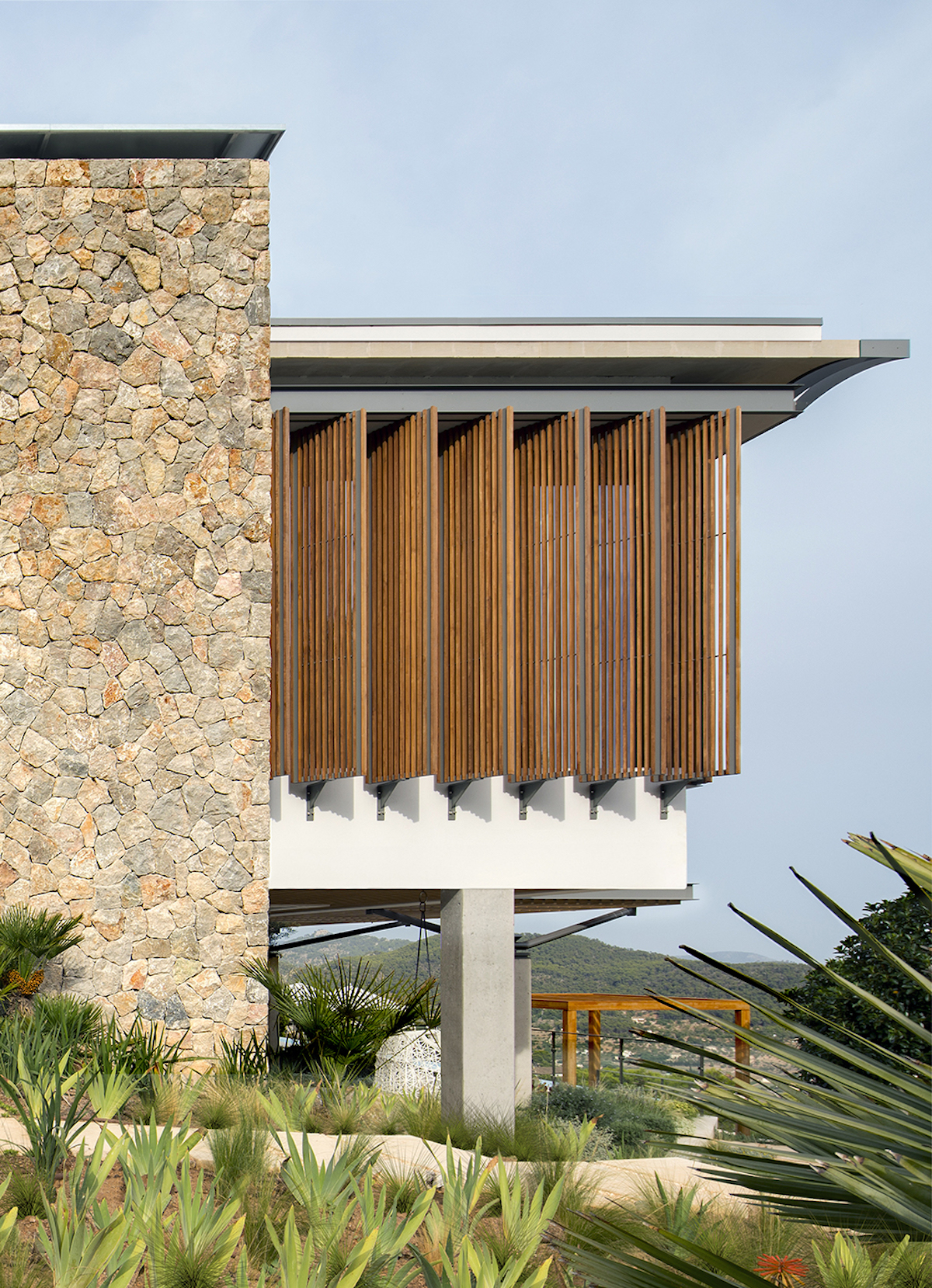 wooden shutters and pergolas help to regulate the sunlight and to ensure the right amount of privacy for the indoor areas