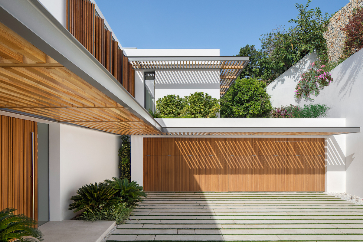 This is a resort-style home with numerous green areas and internal courtyard spaces that separate various functions