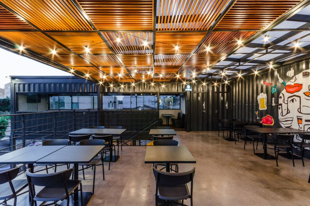 The upper level is a big open space for all the tables and chairs, with warm accent lighting above them