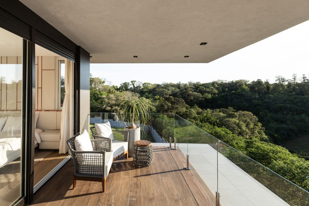 The master bedroom has its own private balcony with a gorgeous view