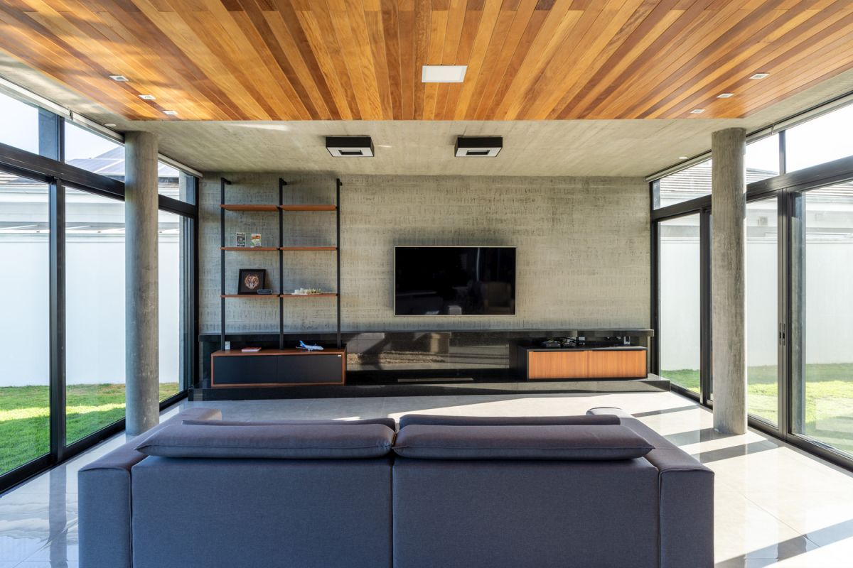 The living room, kitchen and dining area are clustered into a large social volume